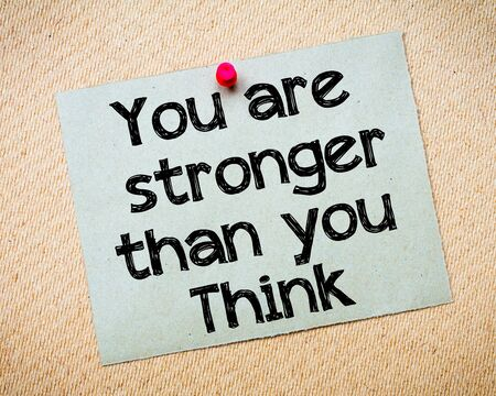 stronger: You are stronger than you think Message. Recycled paper note pinned on cork board. Concept Image