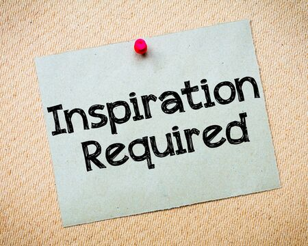 required: Inspiration Required Message. Recycled paper note pinned on cork board. Concept Image Stock Photo