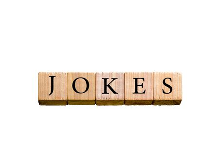 jokes: Word JOKES. Wooden small cubes with letters isolated on white background with copy space available. Concept image.