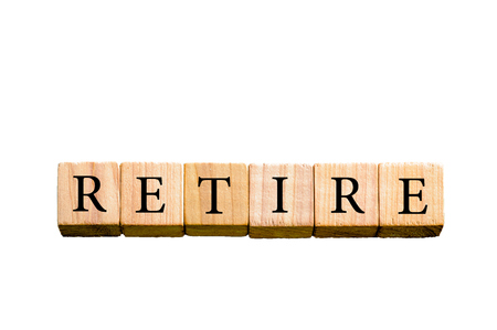 retire: Word RETIRE. Wooden small cubes with letters isolated on white background with copy space available. Concept image. Stock Photo