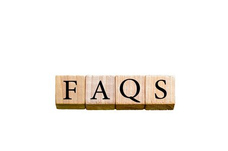 faq's: Word FAQS. Wooden small cubes with letters isolated on white background with copy space available. Concept image.