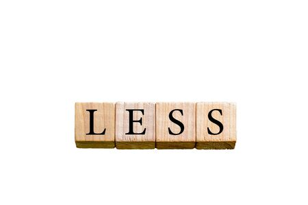 less: Word LESS. Wooden small cubes with letters isolated on white background with copy space available. Concept image.