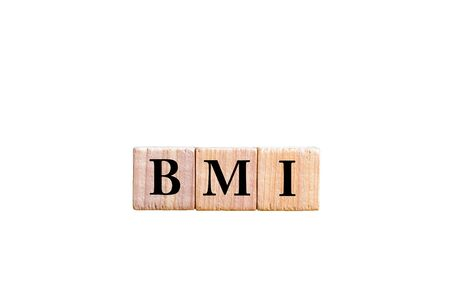 bmi: Acronym BMI - Body Mass Index. Wooden small cubes with letters isolated on white background with copy space available. Concept image.