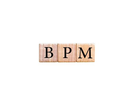 bpm: Acronym BPM - Business process management. Wooden small cubes with letters isolated on black background with copy space available. Business Concept image.