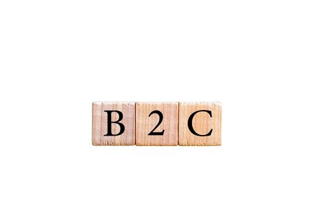 b2c: Acronym B2C- Business to Consumer. Wooden small cubes with letters isolated on white background with copy space available. Business Concept image. Stock Photo