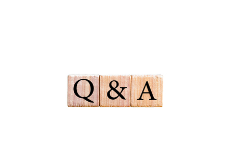 qa: Acronym Q&A - Questions and answers. Wooden small cubes with letters isolated on white background with copy space available. Business Concept image.