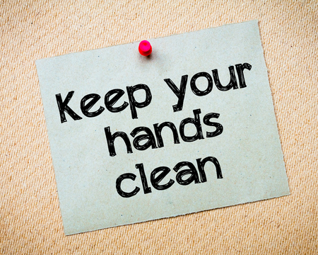keep your hands: Keep Your Hands Clean Message. Recycled paper note pinned on cork board. Concept Image Stock Photo