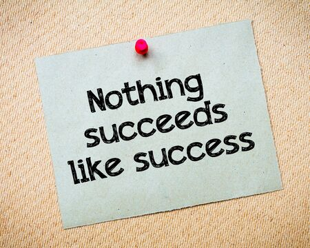 nothing: Nothing succeeds like success Message. Recycled paper note pinned on cork board. Concept Image Stock Photo