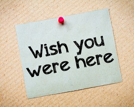 wish desire: Wish You Were Here Message. Recycled paper note pinned on cork board. Concept Image Stock Photo