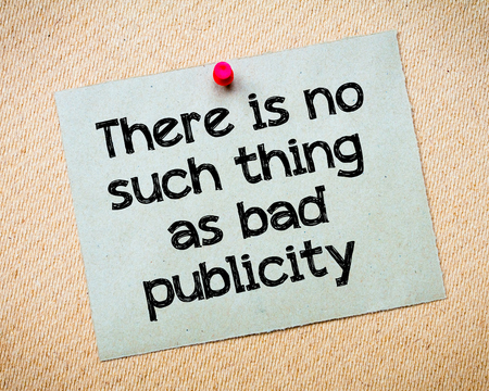 publicity: There is no such thing as bad publicity Message. Recycled paper note pinned on cork board. Concept Image Stock Photo