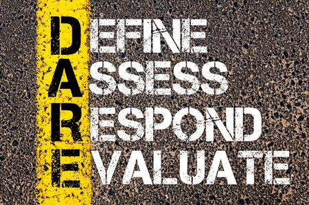 define: Define Assess Respond Evaluate - DARE Concept. Conceptual image with yellow paint line on the road over asphalt stone background. Stock Photo