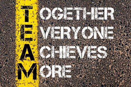 achieves: Together Everyone Achieves More - TEAM Concept. Conceptual image with yellow paint line on the road over asphalt stone background.