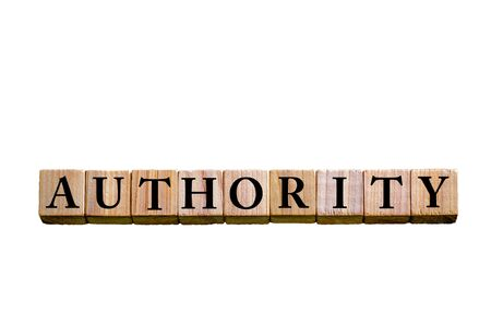 legitimate: Word AUTHORITY. Wooden small cubes with letters isolated on white background with copy space available. Concept image. Stock Photo
