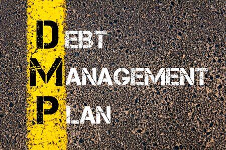 debt management: Acronym DMP - Debt Management Plan. Business Conceptual image with yellow paint line on the road over asphalt stone background.