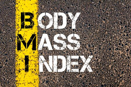 bmi: Acronym BMI - Body Mass Index. Conceptual image with yellow paint line on the road over asphalt stone background.