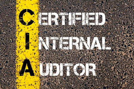 CIA: Business Acronym CIA – Certified Internal Auditor Yellow paint line on the road against asphalt background. Conceptual image Stock Photo