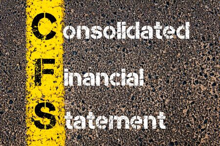 consolidated: Business Acronym CFS � Consolidated Financial Statement. Yellow paint line on the road against asphalt background. Conceptual image