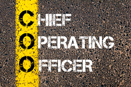 coo: Business Acronym COO – Chief Operating Officer. Yellow paint line on the road against asphalt background. Conceptual image