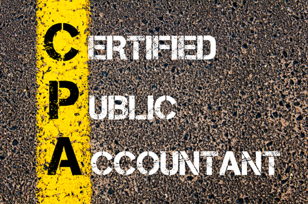 cpa: Business Acronym CPA � Certified Public Accountant Yellow paint line on the road against asphalt background. Conceptual image Stock Photo