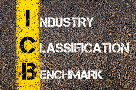 classification: Business Acronym ICB � Industry Classification Benchmark. Yellow paint line on the road against asphalt background. Conceptual image