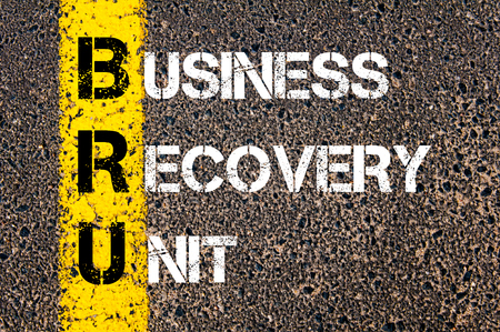 road to recovery: Business Acronym BRU � Business Recovery Unit. Yellow paint line on the road against asphalt background. Conceptual image