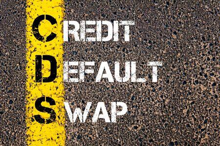 cds: Business Acronym CDS � Credit default swap. Yellow paint line on the road against asphalt background. Conceptual image Stock Photo