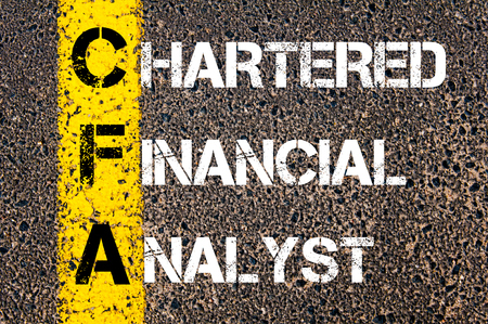 Business Acronym CFA – Chartered Financial Analyst. Yellow paint line on the road against asphalt background. Conceptual image Stock Photo