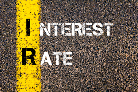 ir: Business Acronym IR - Interest Rate. Yellow paint line on the road against asphalt background. Conceptual image