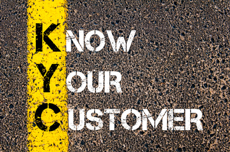 Business Acronym KYC - Know Your Customer. Yellow paint line on the road against asphalt background. Conceptual image Stok Fotoğraf