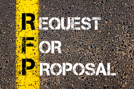 Business Acronym RFP - Request for Proposal. Yellow paint line on the road against asphalt background. Conceptual image