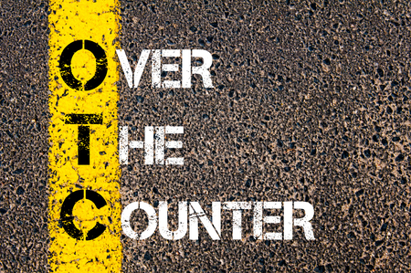 over the counter: Business Acronym OTC - Over The Counter. Yellow paint line on the road against asphalt background. Conceptual image