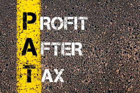 pat down: Business Acronym PAT - Profit After Tax. Yellow paint line on the road against asphalt background. Conceptual image