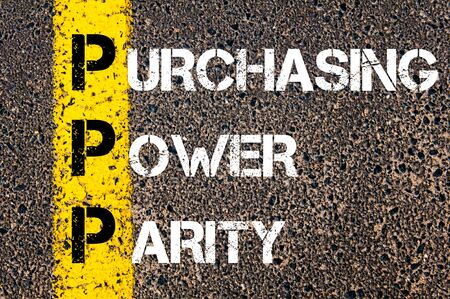 purchasing power: Business Acronym PPP - Purchasing power parity. Yellow paint line on the road against asphalt background. Conceptual image
