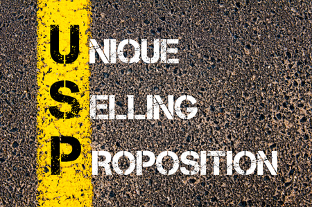 Business Acronym USP as Unique Selling Proposition. Yellow paint line on the road against asphalt background. Conceptual image