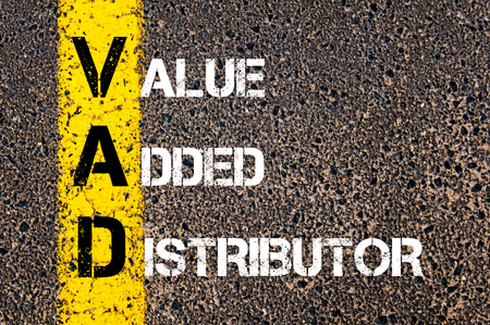 Business Acronym VAD as Value Added Distributor. Yellow paint line on the road against asphalt background. Conceptual image Imagens