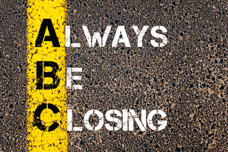 Business Acronym ABC as Always Be Closing. Yellow paint line on the road against asphalt background. Conceptual image
