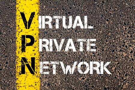 vpn: Business Acronym VPN as Virtual Private Network. Yellow paint line on the road against asphalt background. Conceptual image Stock Photo