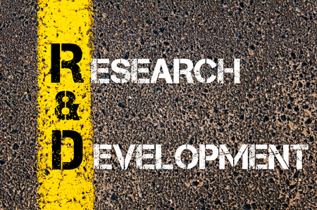 rd: Business Acronym RD as Research and Development. Yellow paint line on the road against asphalt background. Conceptual image