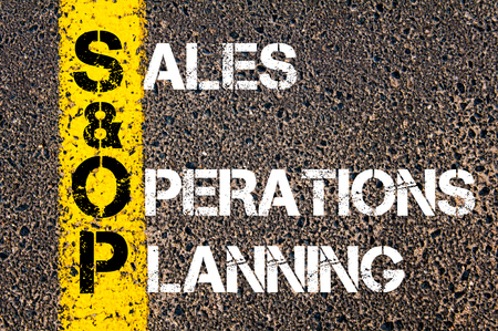 sop: Business Acronym SOP as Sales and Operations Planning. Yellow paint line on the road against asphalt background. Conceptual image