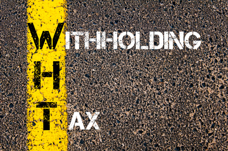 Business Acronym WHT as Withholding Tax. Yellow paint line on the road against asphalt background. Conceptual image Stock Photo