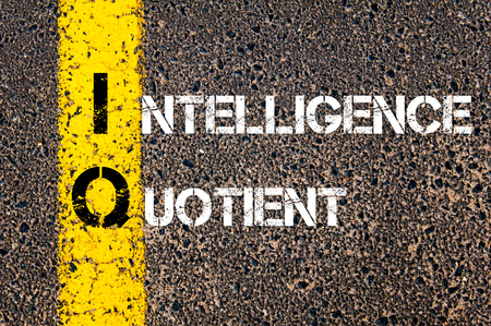 iq: Acronym IQ as Intelligence Quotient. Yellow paint line on the road against asphalt background. Conceptual image