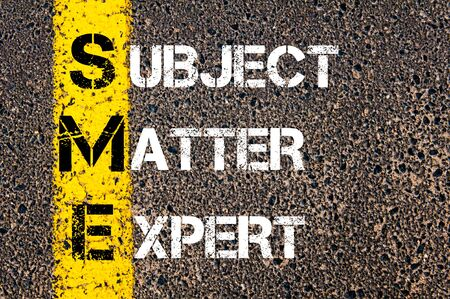 matter: Business Acronym SME as Subject Matter Expert. Yellow paint line on the road against asphalt background. Conceptual image