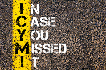 Acronym ICYMI as IN CASE YOU MISSED IT.Yellow paint line on the road against asphalt background. Conceptual image Foto de archivo