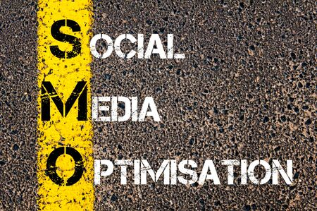 smo: Social Media Acronym SMO as SOCIAL MEDIA OPTIMISATION. Yellow paint line on the road against asphalt background. Conceptual image