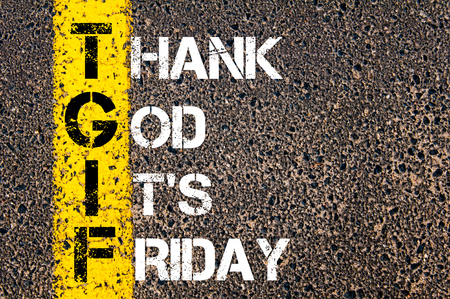 Acronym TGIF as Thank God Its Friday. Yellow paint line on the road against asphalt background. Conceptual image