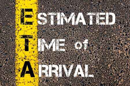 estimated: Business Acronym ETA as ESTIMATED TIME OF ARRIVAL. Yellow paint line on the road against asphalt background. Conceptual image