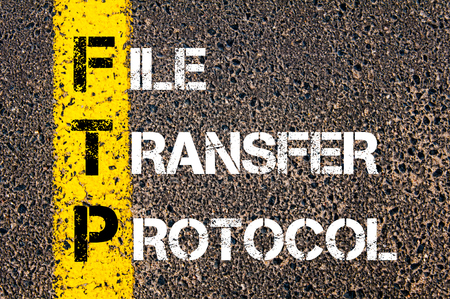 Business Acronym FTP as FILE TRANSFER PROTOCOL.Yellow paint line on the road against asphalt background. Conceptual image