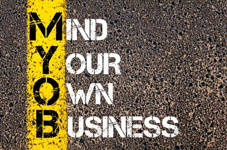 business mind: Business Acronym MYOB as MIND YOUR OWN BUSINESS. Yellow paint line on the road against asphalt background. Conceptual image