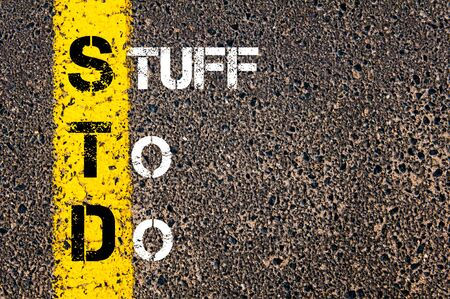 std: Business Acronym STD as STUFF TO DO. Yellow paint line on the road against asphalt background. Conceptual image Stock Photo