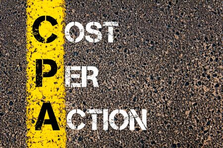 cpa: Business Acronym CPA as COST PER ACTION. Yellow paint line on the road against asphalt background. Conceptual image